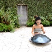 Watch this woman perform jaw-dropping music with just her hands and a metallic turtle shell.